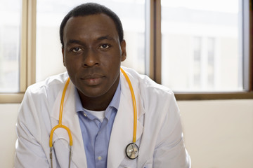 Doctor with stethoscope, front view, portrait