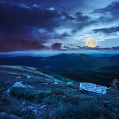 boulders on the hillside in high mountains at night