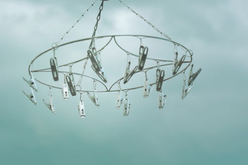 Clothespins on hanging  against the sky.