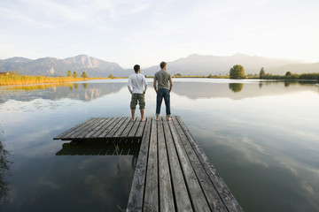 Two men standing on a pier.