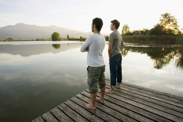 Two men standing on the pier.
