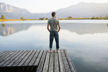 A man standing on a pier.