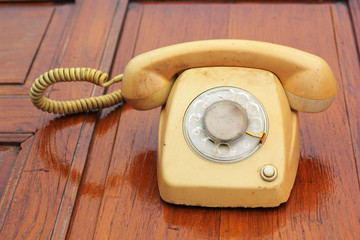 old phone vintage style on the wooden floor.