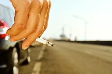 man smoking on a no traffic road
