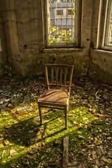 Old chair in an abandoned dilapidated house 2