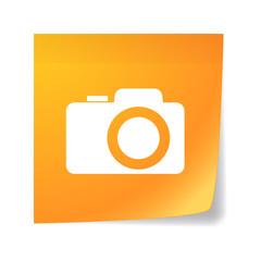 Orange sticky note with a photo camera
