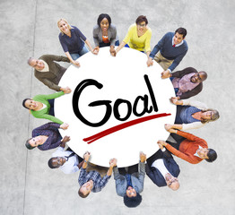 Group of People Holding Hands and Word Goal