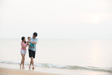 Portrait of an asian family on beach
