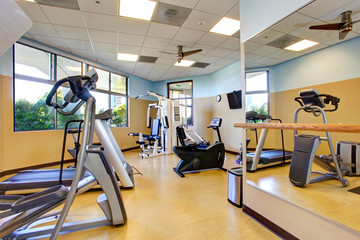 Bright gym room in residential building