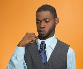 Man in awkward hot situation, blowing air, pulling shirt