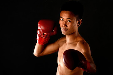 Muay Thai boxing male boxer isolated on black backgrounds