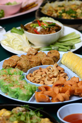 Set of Thai and Chinese Food on Table