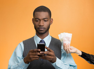 man texting, reading news on smart phone earning money