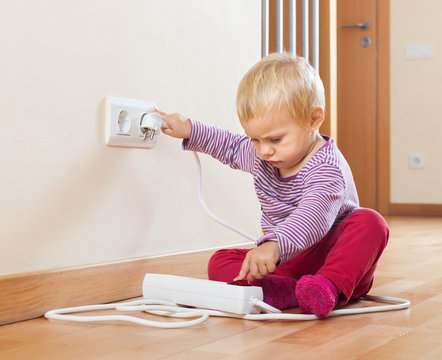 Baby playing with electrical extension