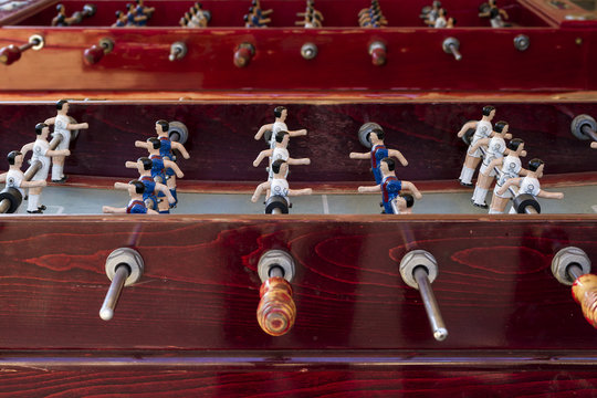 An old foosball with FC Barcelona and Atletico Madrid FC teams