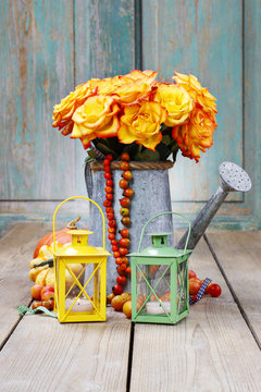 Bouquet of orange roses in silver watering can