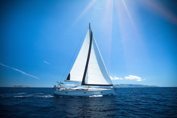 Yacht in the bright sunlight. Luxury yachts.