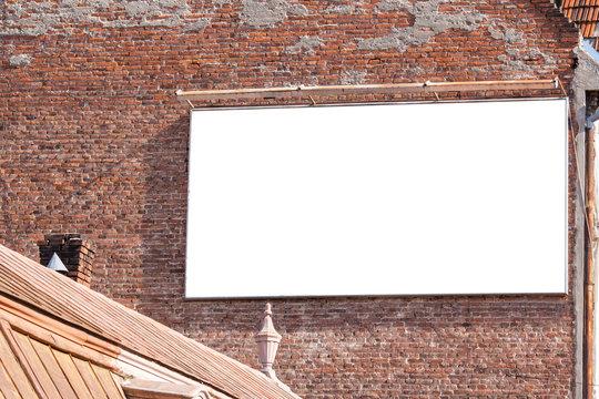 blank billboard on a brick building
