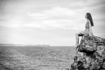 Beautiful woman on the cliff and sea
