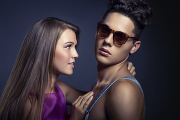 Fashion portrait of young beautiful couple