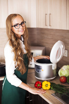beautiful girl with slo-cooker