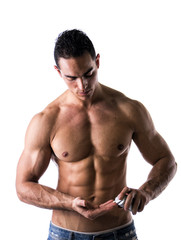 Male model putting cream in his hand