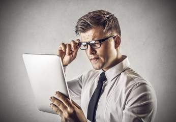 businessman looking something wrong on the tablet