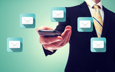 Businessman with email and cell phone