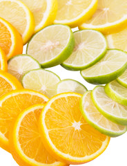 Lime, lemon and orange layer slices over white background