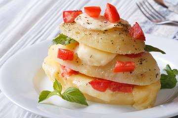 Boiled new potatoes with mozzarella, tomato and basil