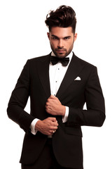 stylish man in elegant black suit and bowtie