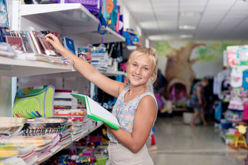Schoolgirl buys exercise book Office goods in store for school
