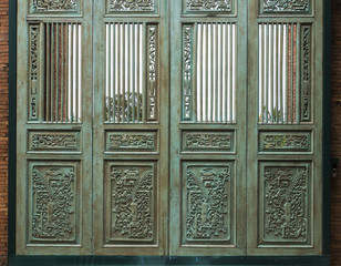 wooden carved blue door