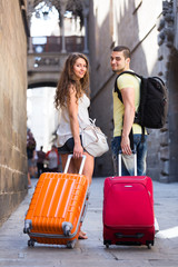 couple  traveling with suitcases