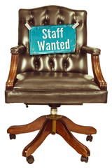 Retro office chair with staff wanted sign isolated on white