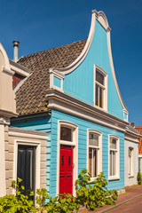 Colorful ancient blue wooden house in The Netherlands