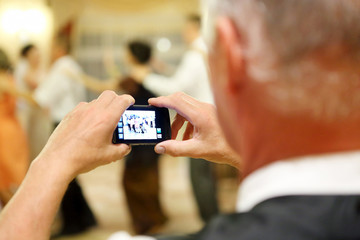 Man making a picture during the reception party