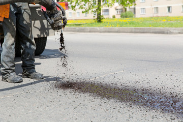 Patch Pothole Repair on Road by means bitumen and gravel