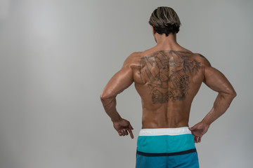 Portrait Of A Physically Fit Man Back Poses