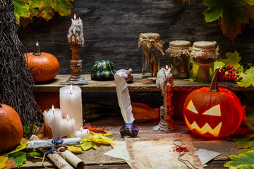 Table in witch hut with halloween pumpkin