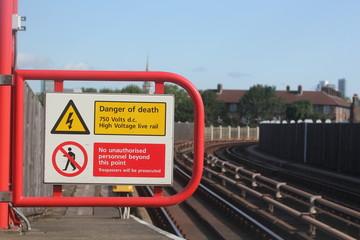 electric shock hazard no entry sign rail train station