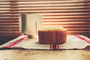 Bread and breadmaker tin by the window