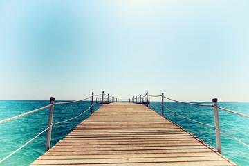 Pier in blue sea vintage toning