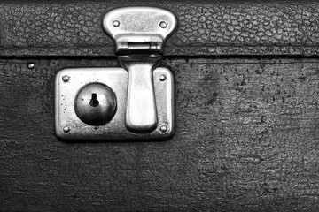 closed lock of an old suitcase black color