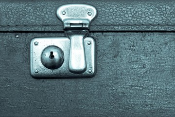 closed lock of an old suitcase blue color
