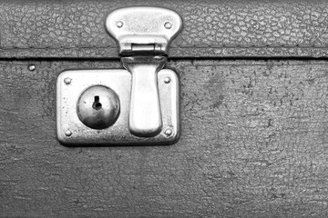 closed lock of an old suitcase gray color