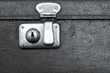 closed lock of an old suitcase silvery color