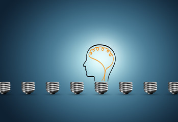 Light bulb on blue background, the concept of idea