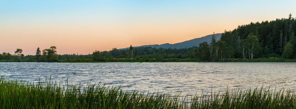 Panorama of a small lake at dusk