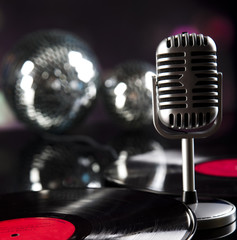 Microphone, vinyl record and Disco Balls